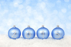 2015 New year text on christmas baubles Royalty Free Stock Photos