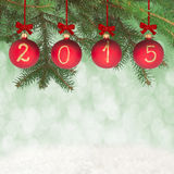 2015 New year text on christmas baubles Stock Photos