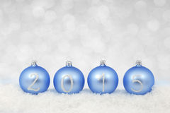 2015 New year text on christmas baubles Royalty Free Stock Photo