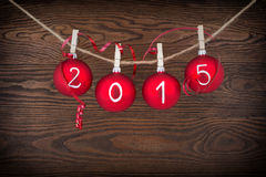 2015 New year text on christmas baubles Royalty Free Stock Image