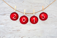2015 New year text on christmas baubles Royalty Free Stock Photography