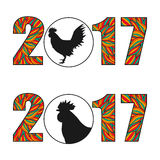 New Year 2017 text design. Multicolored figures silhouette symbol of the year rooster Stock Photos