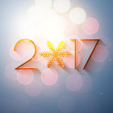 New Year 2017 text design. Vector greeting illustration with golden numbers and snowflake royalty free illustration