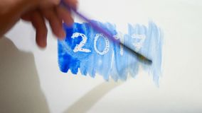 2017 new year text inscription watercolor artist paints blot isolated on white background art. 2017 new year text inscription watercolor artist paints blot stock video