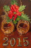 2015 New year text and two glasses of cognac. With christmas star on wood Royalty Free Stock Images