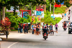 New year in Thailand. KOH SAMUI, THAILAND - APRIL 13, 2014: New year celebrations in Thailand. People pour water on the road having fun. Sunny day at Samui Royalty Free Stock Photo