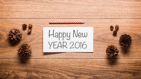 New Year theme background, pine cones and a card Stock Photography
