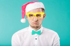 New Year theme Christmas winter holidays office company employees. portrait Caucasian male business funny Santa Claus hat glasses stock image