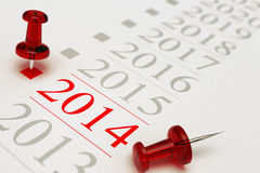 New Year 2014, Timeline. Two red pushpins over a timeline, the first one is pointing on the year 2014, grey background, copy space and blur effect Royalty Free Stock Image