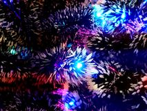Free New Year Tinsel With Neon Lights On A Christmas Tree Closeup Stock Photos - 106908943
