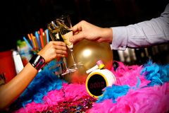 New year toast. New year champaign toast over clock midnight Royalty Free Stock Image
