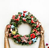 2018 New Year. Christmas wreath. toned picture. Christmas holiday. Christmas wreath in the hands of women on white. Chris. 2018 New Year. toned picture royalty free stock photos
