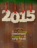 New Year 2015 of torn paper against wood background Stock Photo