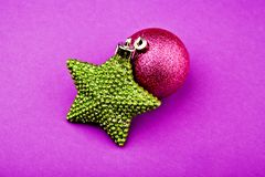 New year toy ball green star purple background studio. Quality stock image