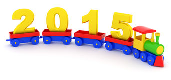 2015 New Year. The toy locomotive transports 2015 new year Royalty Free Stock Photos