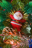 The new-year toy of Santa claus hangs on a christmas tree Royalty Free Stock Photo