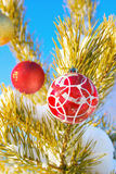 New Year toys hang on a snow-covered pine branch Royalty Free Stock Photography