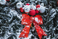The New Year tree on the city square is decorated with beautiful. Spheres and garlands and Christmas tree decorations all sparkles betrays magic mood of a Royalty Free Stock Image