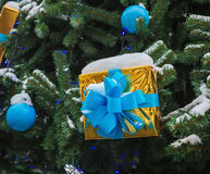 The New Year tree on the city square is decorated with beautiful spheres and garlands Stock Photos