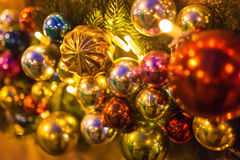 The New Year tree on the city square is decorated with beautiful spheres and garlands. And Christmas tree decorations all sparkles betrays magic mood of a Royalty Free Stock Photo