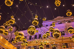 The New Year tree on the city square is decorated with beautiful spheres and garlands Stock Photo