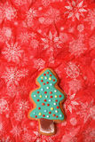 New year tree cookie. New year and christmas cookie green on red background vertical, free space Stock Images