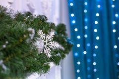 New Year tree decorated with blue toys - gifts and balls. blur Blue bokeh background for festival celebration Christmas, Happy New Royalty Free Stock Images