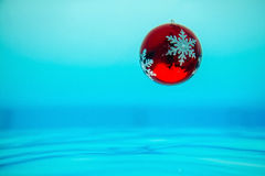 New year tree decoration flowing in the blue water Stock Photography