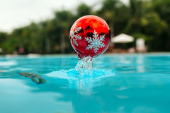 New year tree decoration splashes from the bleu water Royalty Free Stock Photo
