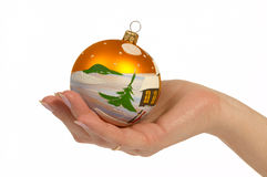 New-Year tree decorations. Woman hold a ball Stock Images