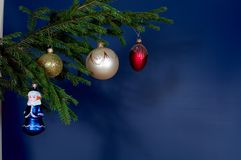 New-Year tree decorations. On blue stock images