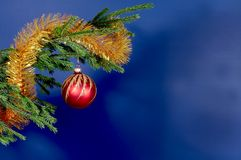 New-Year tree decorations. On blue stock image