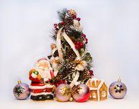 New Year tree Father christmas. New Year tree, Father christmas, candle house  and variegated balls Stock Photo