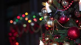 New Year background with presents and flashing garland on the tree. New Year tree with flashing garland. Christmas interior background stock footage