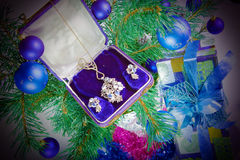 On a New Year tree a gift - jewelry.  Stock Images