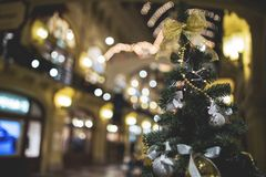 New Year tree. photo toned. New Year fir tree with decorations in a trading hall. photo toned Stock Photos