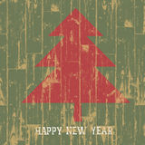 New year tree symbol with greetings on wooden plan Royalty Free Stock Photo