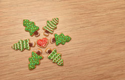 New year trees cookies with heart cookie, free space, horizontal. Cookies on wooden background, free space, green and red Royalty Free Stock Photo