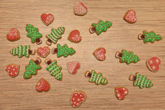 New year trees cookies with heart cookie, free space, horizontal. Cookies on wooden background, free space, green and red Stock Photo