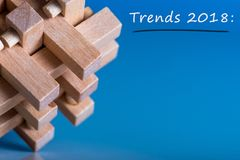 2018 new year TRENDS. New trend at business innovation technology and other areas. Blue background with macro view of. Brain teaser and empty space for text stock images