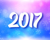 New Year 2017 typography on festive background. New Year 2017 greeting card with magic light and snow on colorful blue-purple background. Vector design with Royalty Free Stock Photo
