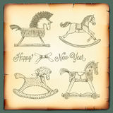 New Year Vintage Card With Rocking Toys Horses Royalty Free Stock Image