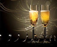 New Year, wedding or anniversary champagne. New Year, wedding or anniversary background of two elegant flutes of champagne with swirling light and twirled party Royalty Free Stock Image