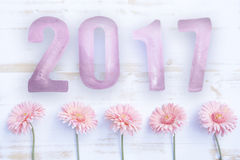 New Year 2017 on white board with pink daisies Royalty Free Stock Photography