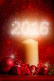 2016/New Year. White candle / candle light 2016 red background with bokeh Royalty Free Stock Photos