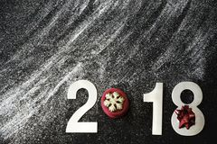 New Year 2018, white glitters scattered, glisten and shimmer on a black background, copy space for your text.  stock photos