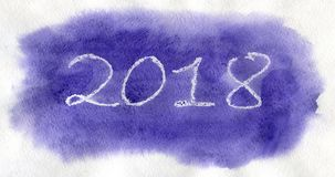 New Year 2018. White lettering on the viole watercolor background. New Year 2018. White lettering made by wax crayons on the viole watercolor background Royalty Free Stock Photography
