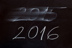 New year 2016. 2015 wiped off and 2016 written with chalk on blackboard Stock Photos