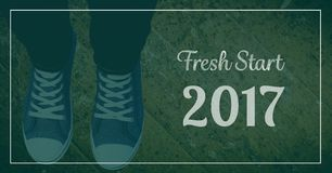 2017 new year wishes with teenager wearing sneakers. Against wooden background Stock Photos