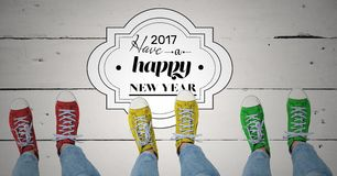 2017 new year wishes with teenagers wearing colourful sneakers. On wooden background Stock Image